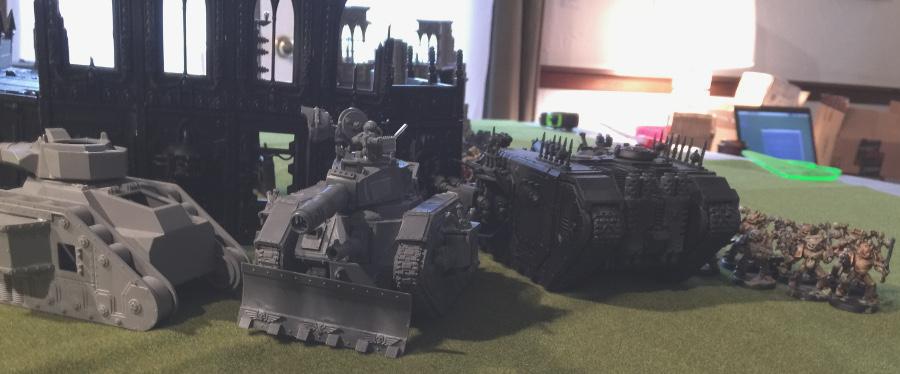 http://www.aurumvorax.com/files/batreps/2000-wolves-vs-allied-ig-chaos-20160402/14-26-ch1-plague-marines-advance-behind-tanks.jpg