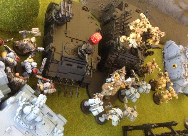 http://www.aurumvorax.com/files/batreps/20150530-W-vs-CSM-IG/15-50-C2-more-rhinos-wrecked-nurgles-bolter-fire.jpg