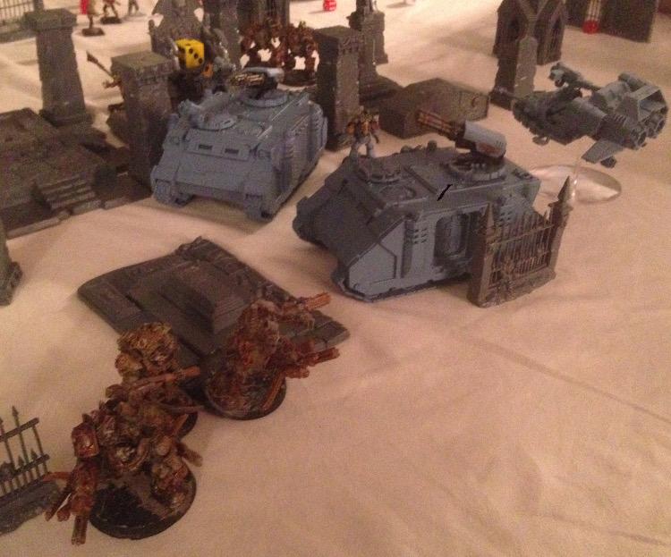 http://www.aurumvorax.com/files/batreps/20150821-SW-vs-CSM/3063-21-20-52-chaos-5-wolves-warlord-fled.jpg